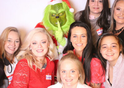 Christmas Themed Group Photo with Grinch being featured